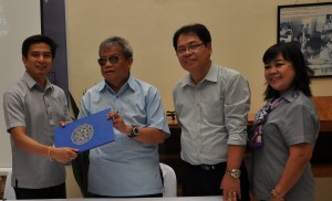 Deputy Executive Director Mateo A. Lee, Jr. (2nd from left) of the National Council on Disability Affairs (NCDA)  receives a copy of translated Filipino disability laws from Dr. Banjamin M. Mendillo, Jr. of the Commission on the Filipino Language during the turnover ceremony held at the NCDA Office in Quezon City.  Witnessing the turn-over are: Mr. Rizalio R. Sanchez, Chief of Information, Education and Communications Division and Ms. Delfina J. Baquir, Information Officer IV of NCDA.