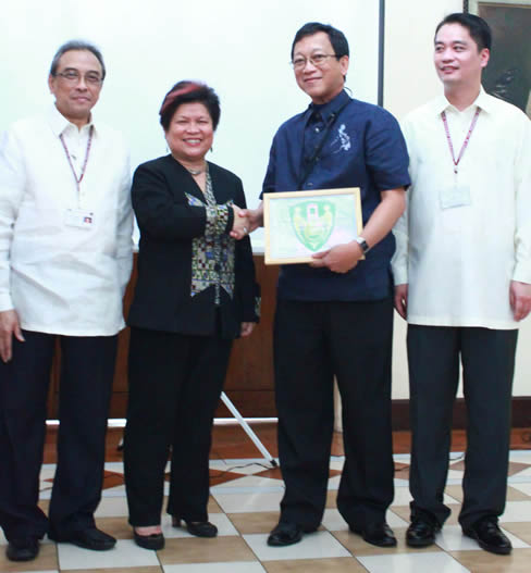 In the photo from right to left, are Chancellor Ramon Arcadio,  Secretary Corazon (Dinky) Soliman, Eng'r. Emer Rojas (awardee) and Dr. Rolando Domingo, the UP-PGH Hospital Director.