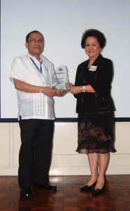 Architect Mariano C. del Castillo receives from NCDA Chairperson Rosie Lovely Romulo, on behalf of DPWH Asec. Dimas S. Soguilon, the Plaque of Appreciaton, for the success of the 2010 NDPR Week.  Also for DPWH Secretary Gogelio Singson's endorsement of Php 5.3 Million which includes ramp construction in the repair of the pedestrian overpass in Commonwealth fronting GOTESCO