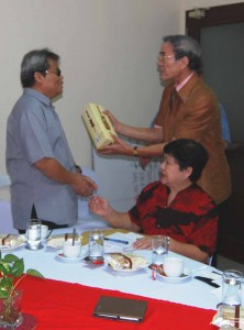 Mr. Andoh presents token of appreciation to NCDA OIC Mr. Mateo A. Lee, Jr.