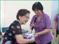 Ms. Kapunan while receiving the Token of Appreciation from Ms. Floree Bisco - Planning Officer III of NCDA